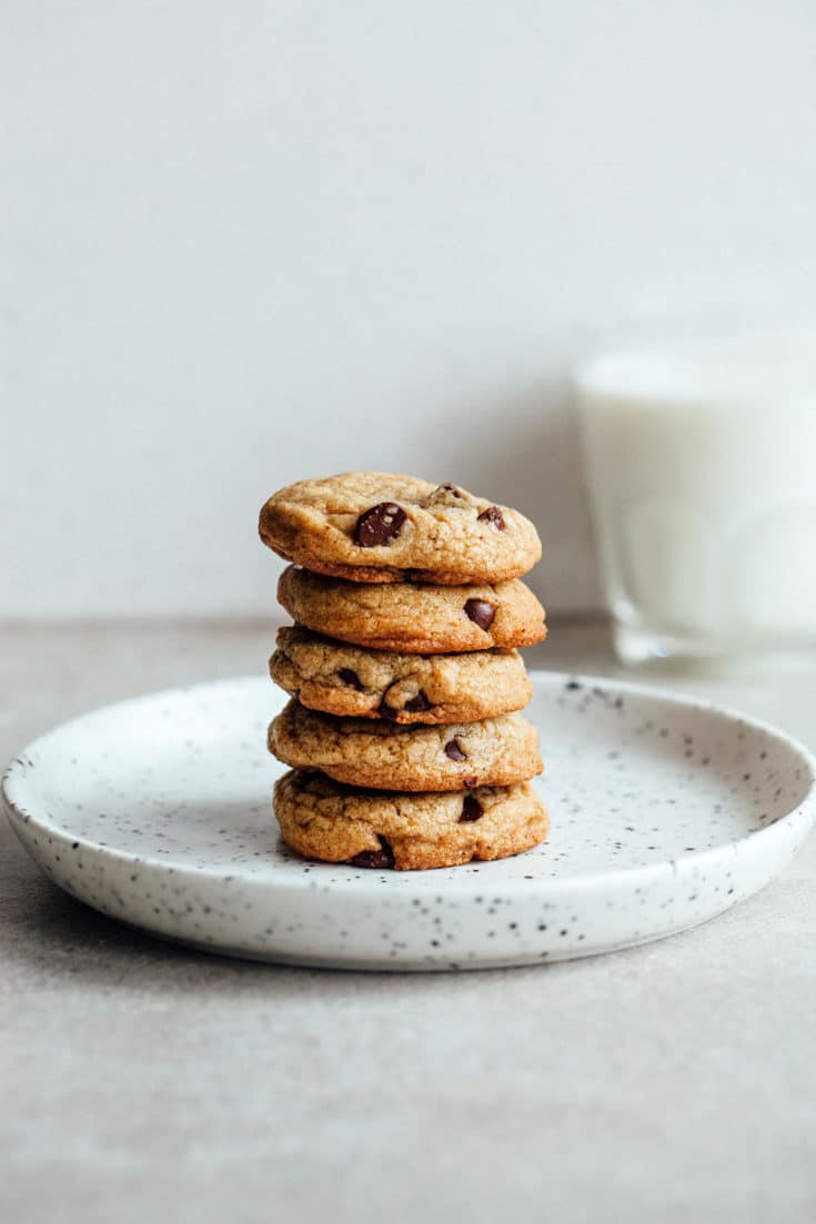 A stack of brown butter chocolate chip cookies on a plate.