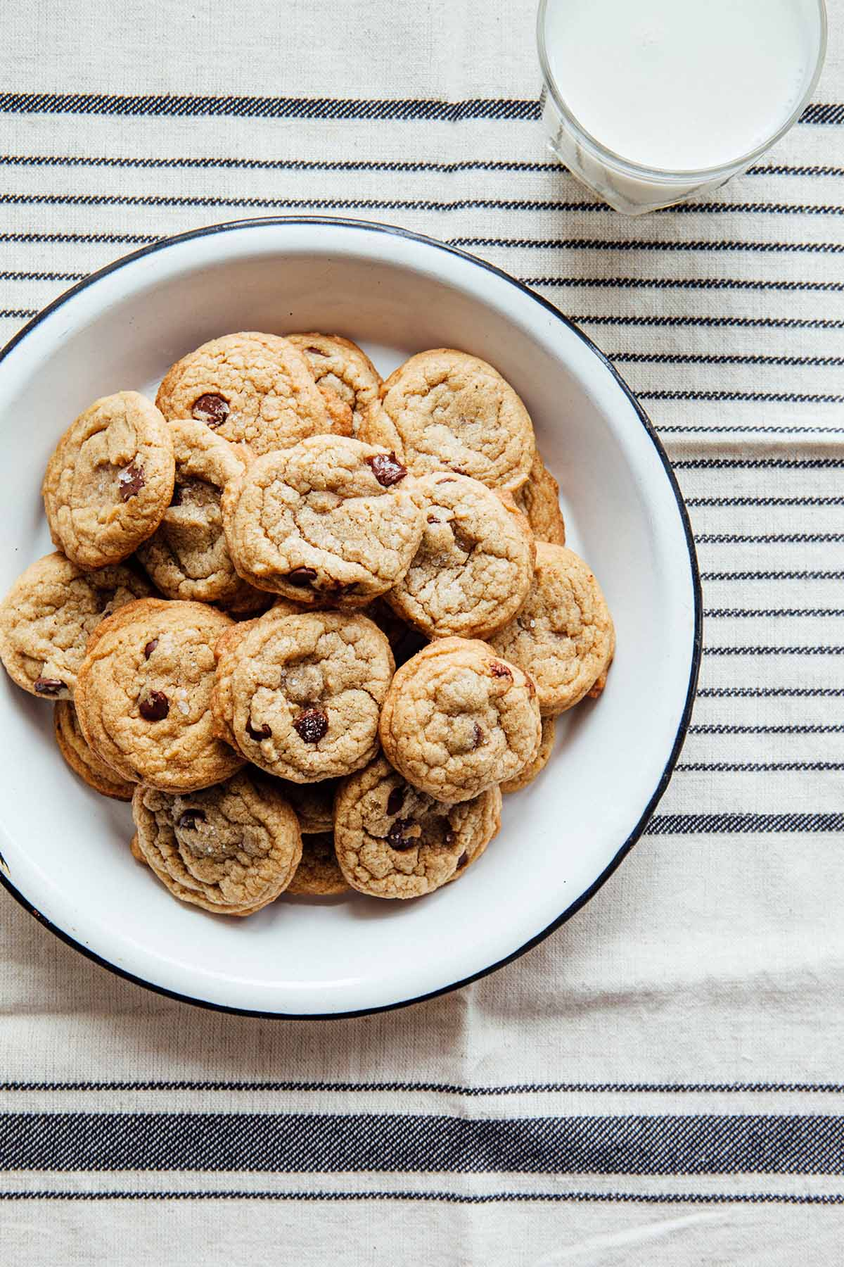 A plate filled with brown butter chocolate chip cookies.