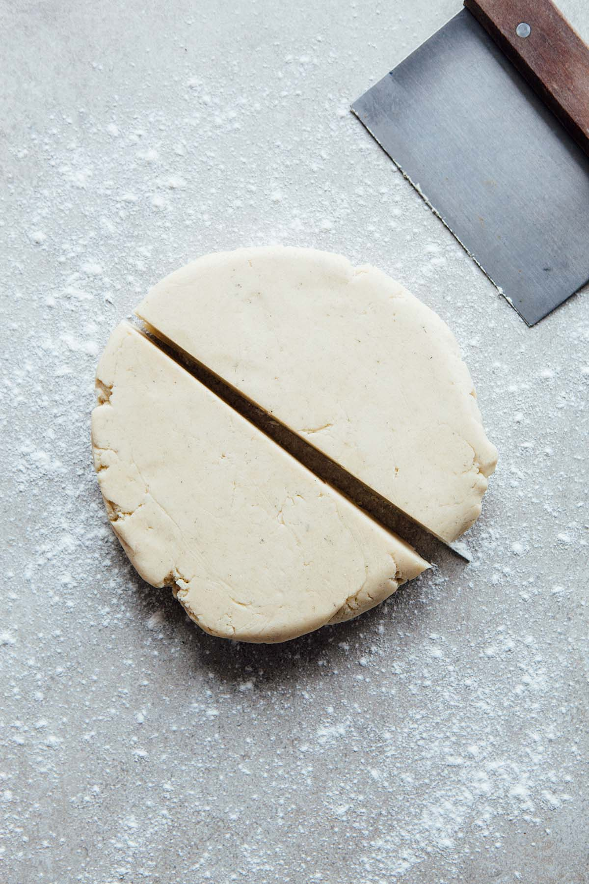 A disc of chilled cookie dough cut in half.