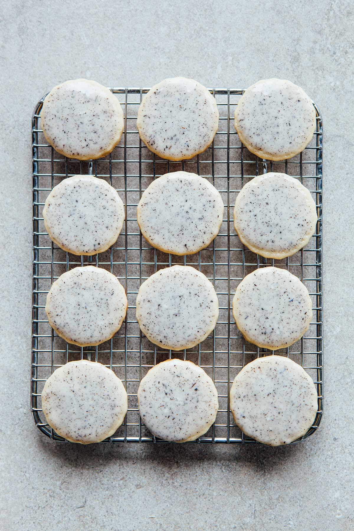 Lavender sugar cookies cooling on a rack.