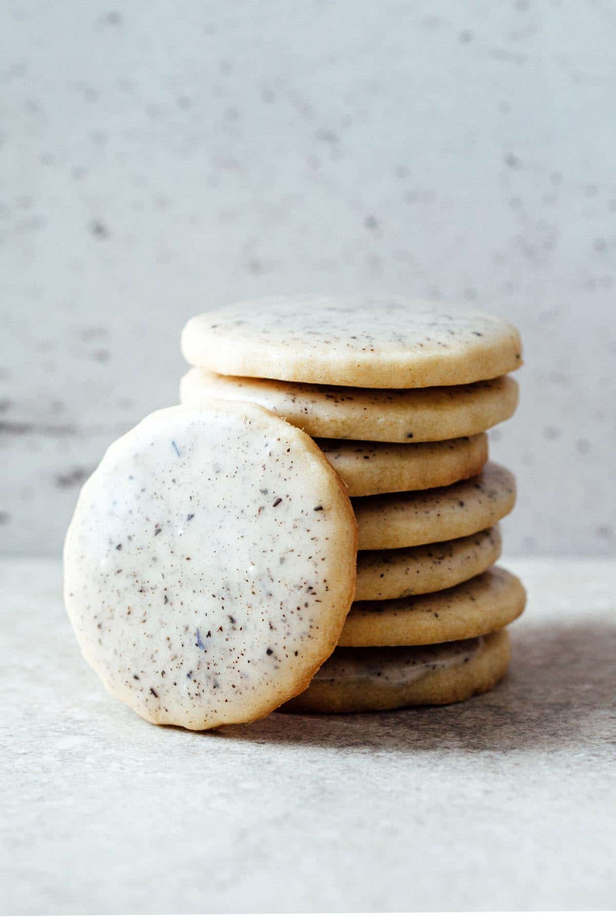 A stack of lavender sugar cookies with Earl Grey glaze.