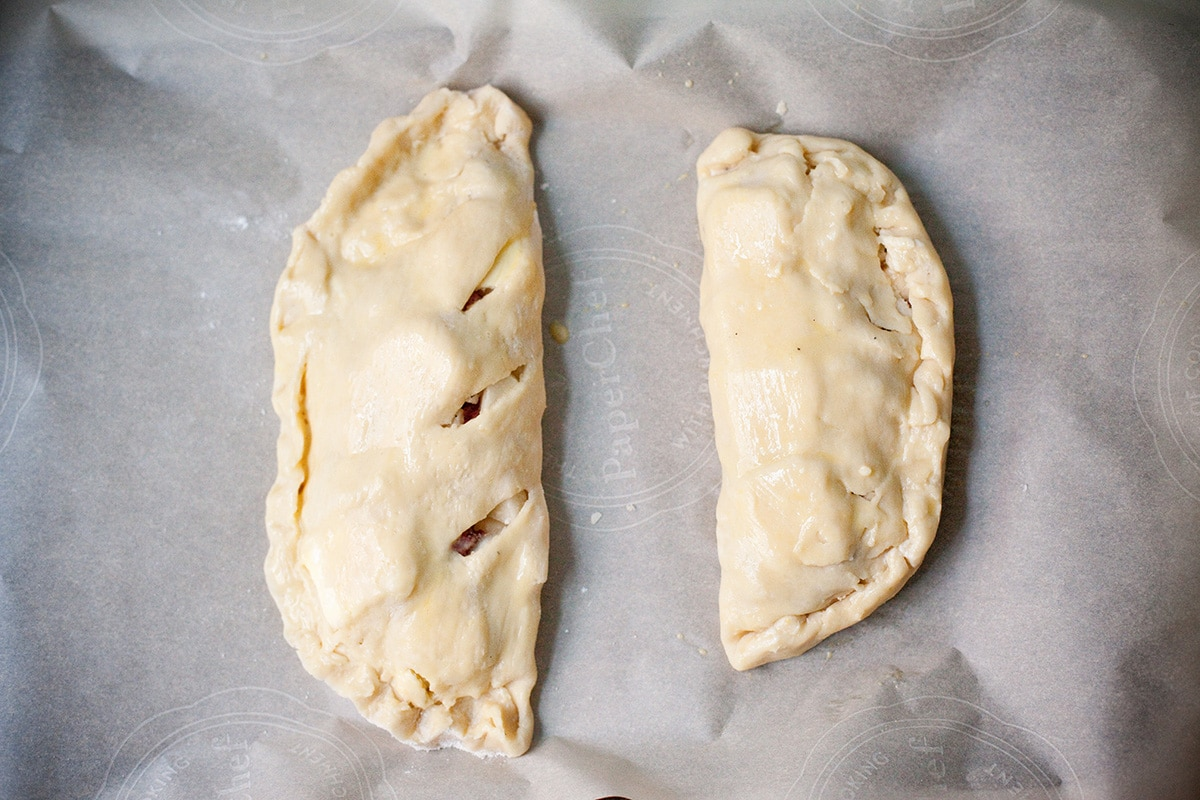Two unbaked traditional Cornish pasties.