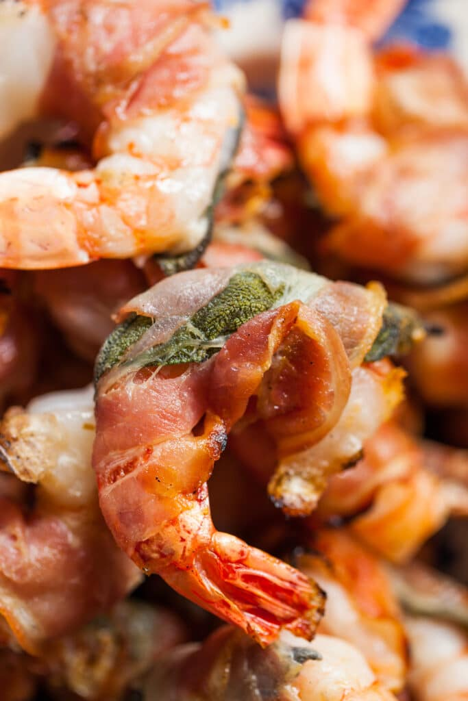 Close up of a pancetta-wrapped shrimp.
