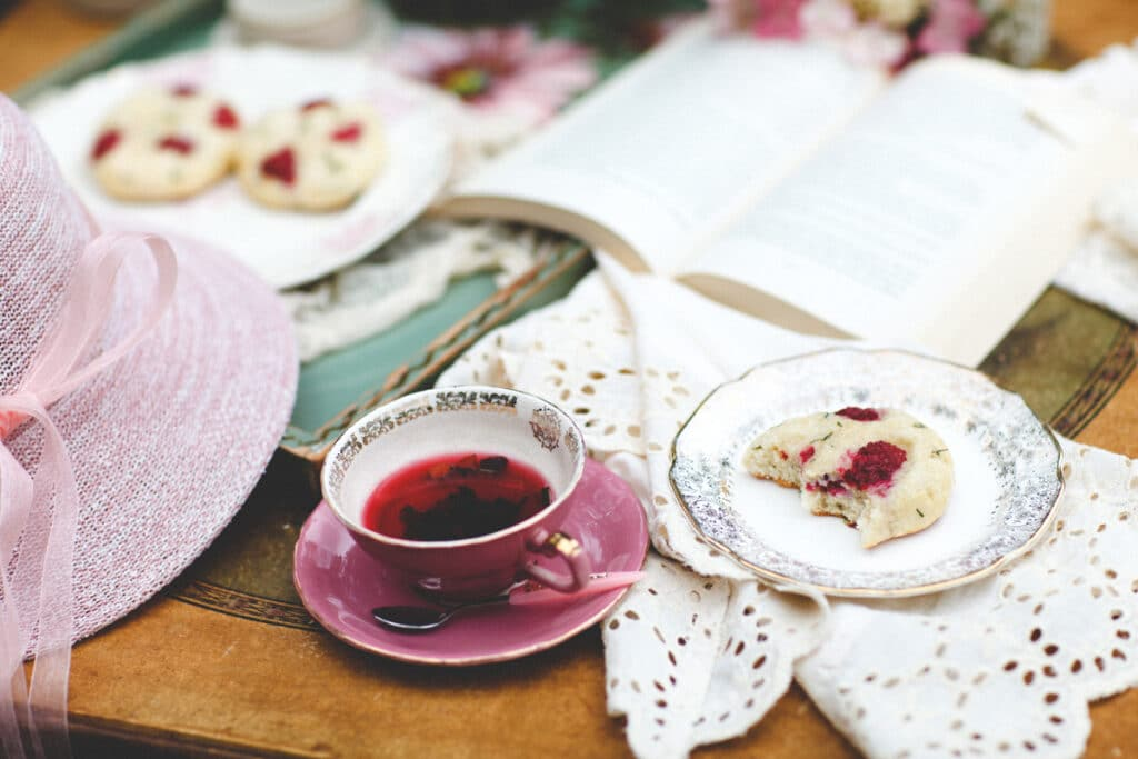 Afternoon tea for one with scones and a book.