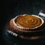 A pie on a wooden board.