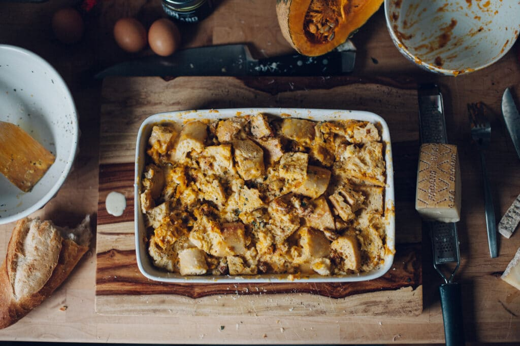 Unbaked roasted squash, chorizo, and blue cheese strata.