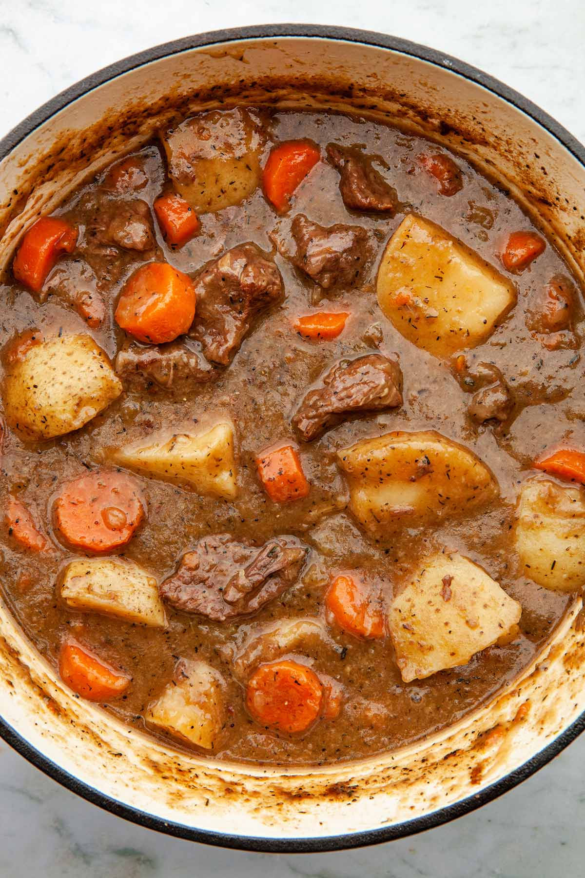 Close up overhead image of a pot of beef stew.