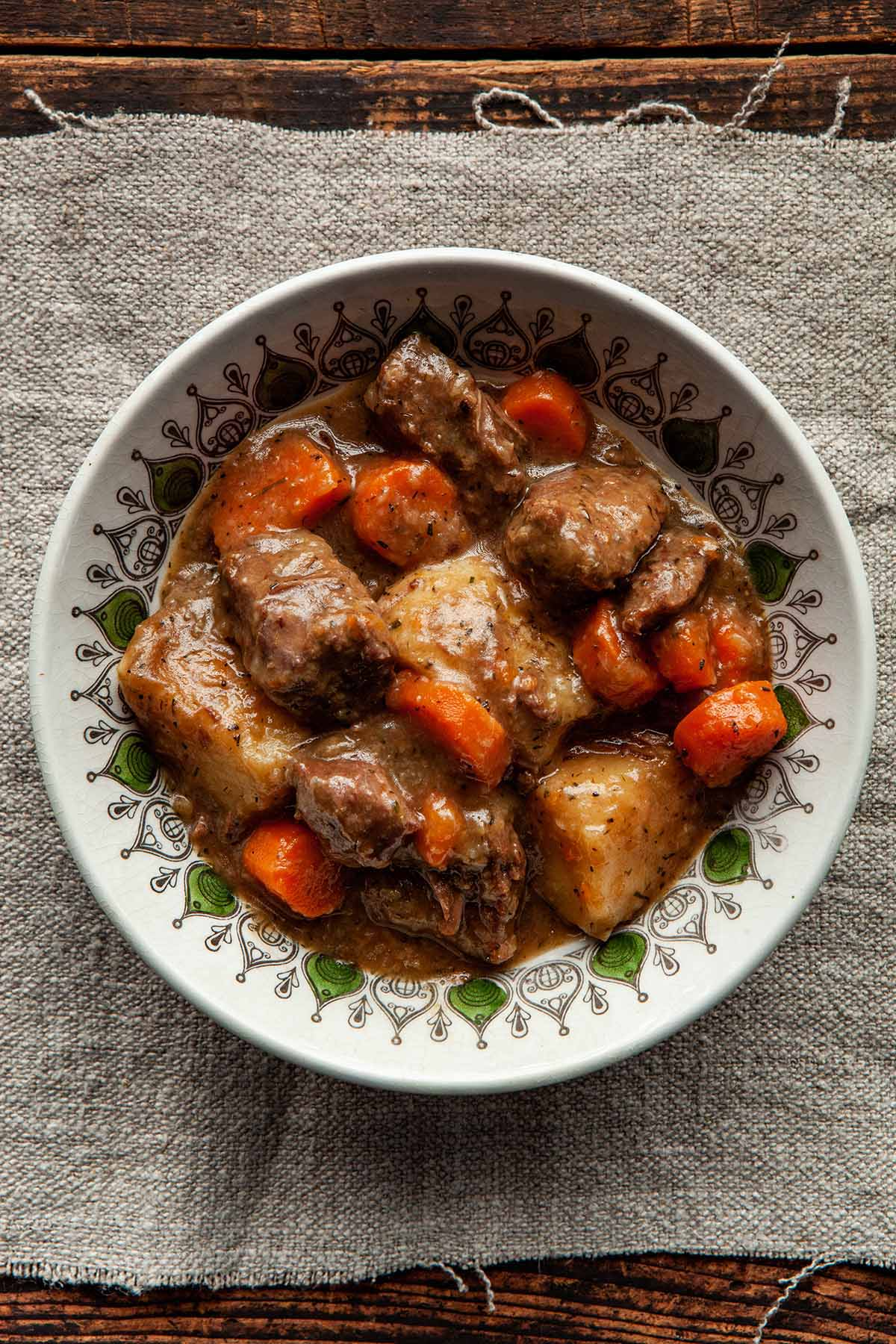 Close up overhead image of a bowl of Dutch oven beef stew.