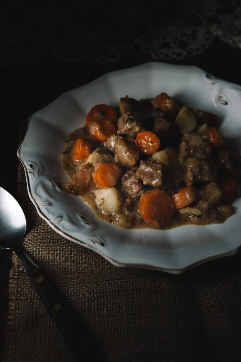 A bowl of Dutch oven beef stew with summer savory.