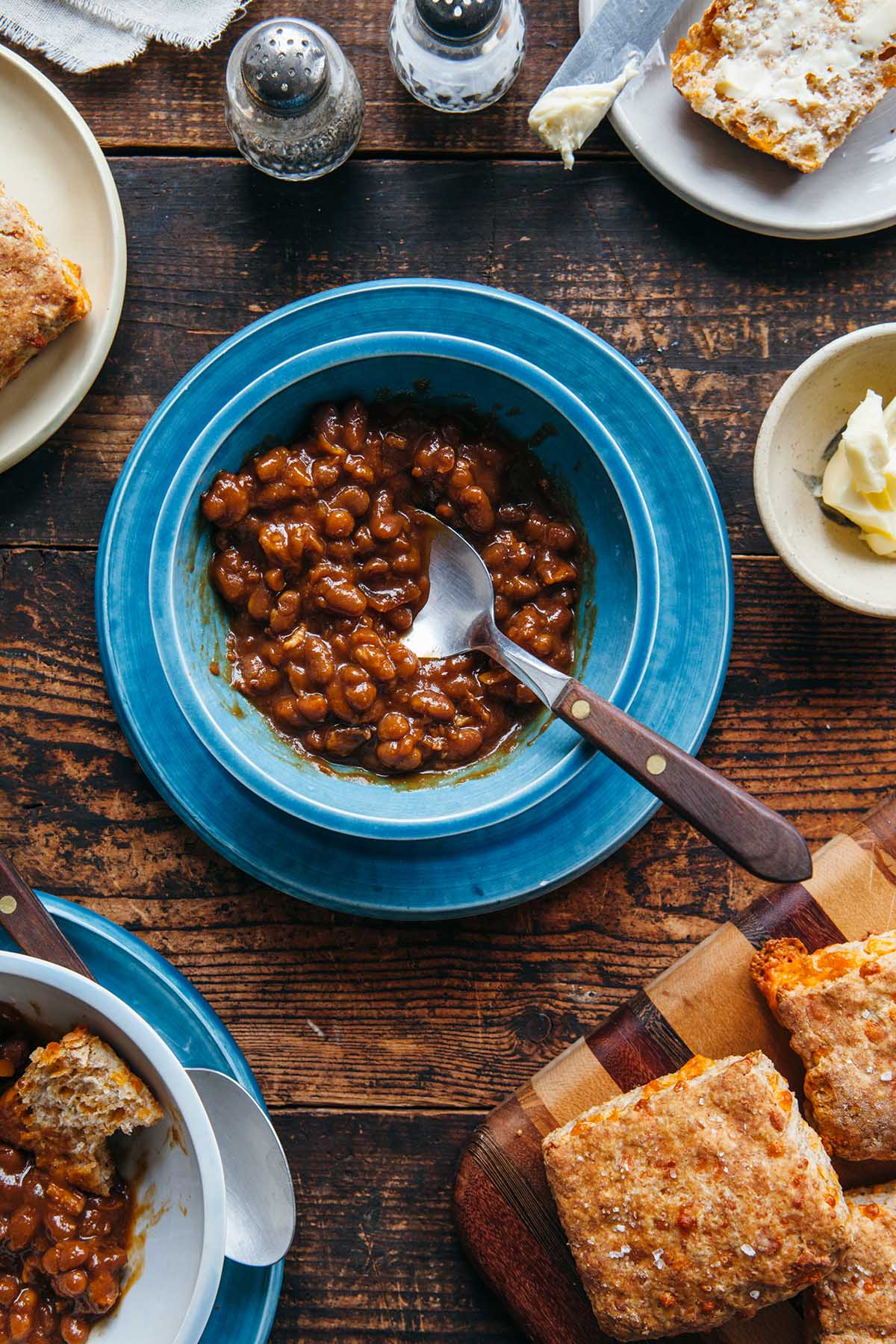 A bowl of homemade molasses baked beans with bacon.