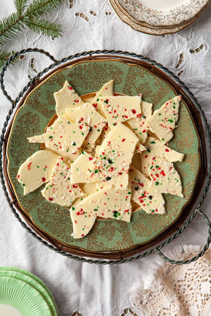 A plate of white chocolate candy cane bark pieces.
