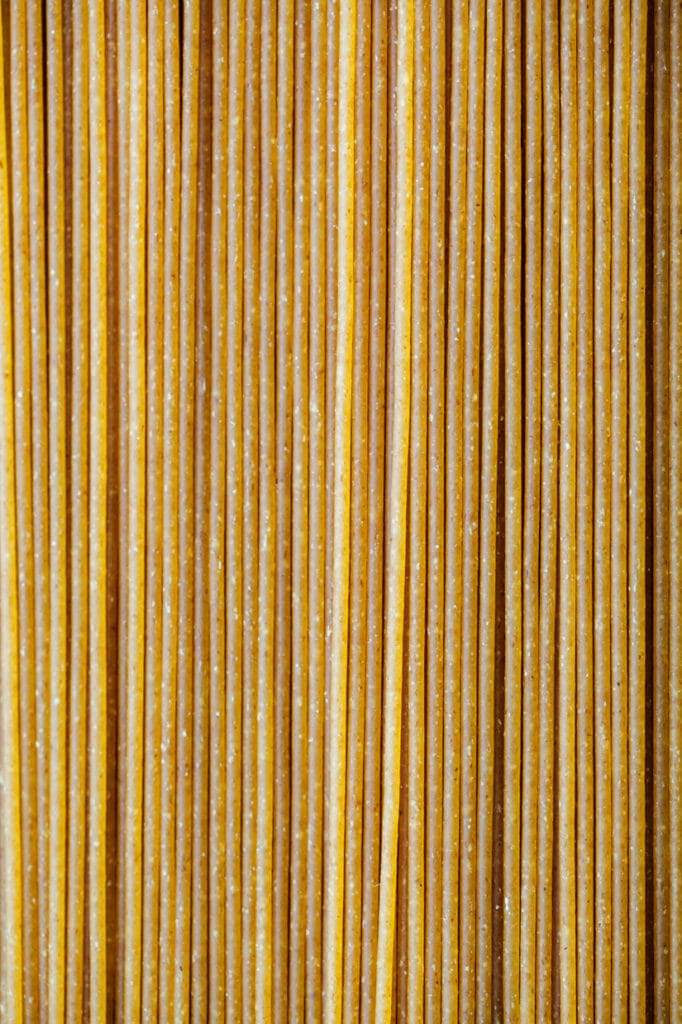 Close up of uncooked whole grain spaghetti.