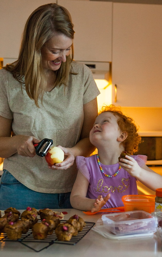 Nova Scotia food photographer Kelly Neil peeling an apple with her daughter Elodie.