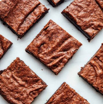 Overhead shot of double chocolate buckwheat brownies on a marble board.
