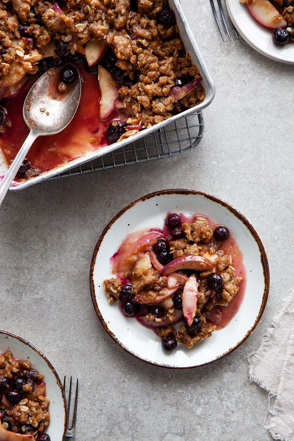 Vegan gluten-free nectarine blueberry crisp on a plate.