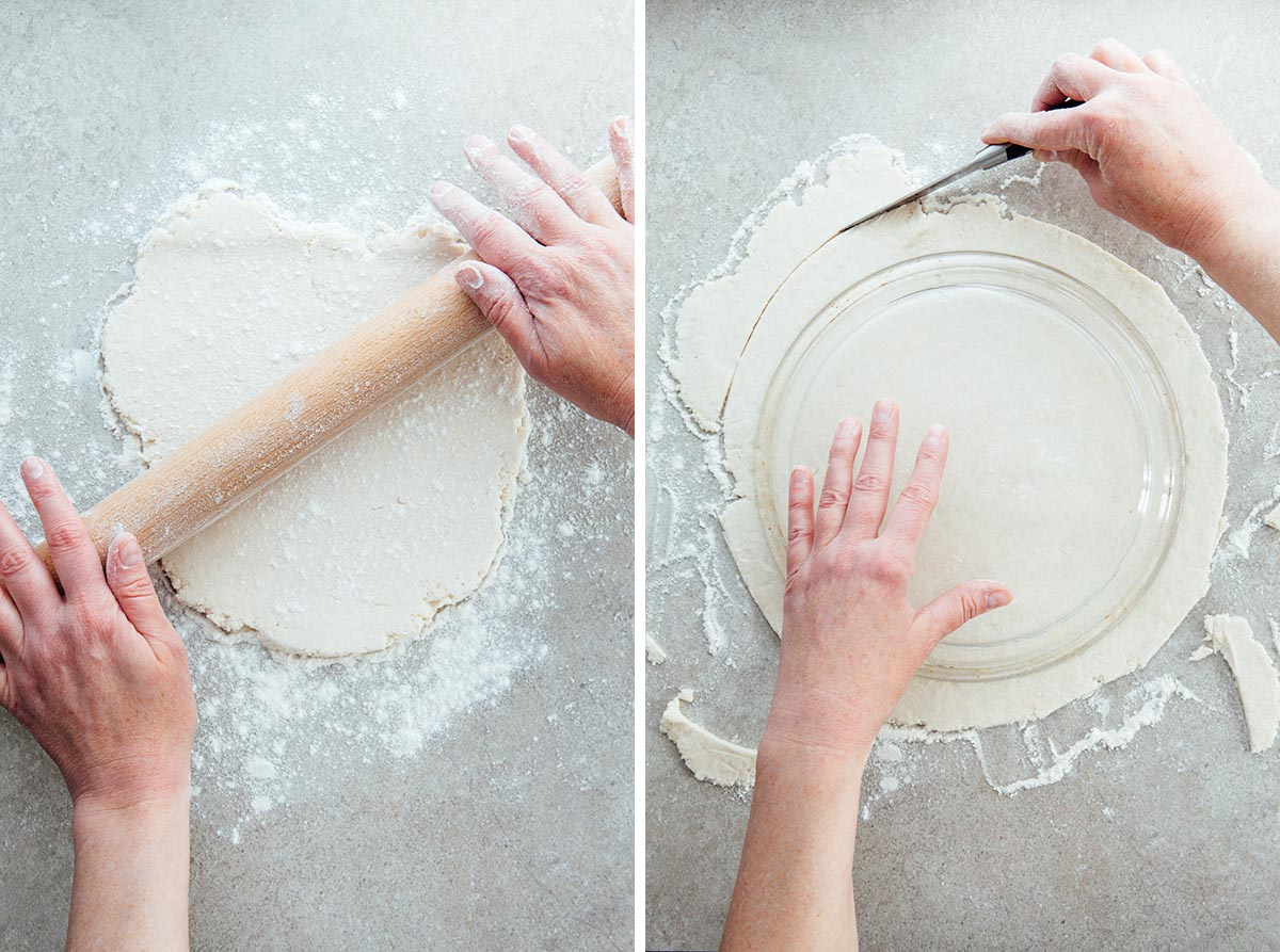 Hands rolling pie dough and cutting the edges to fit into a pie plate.