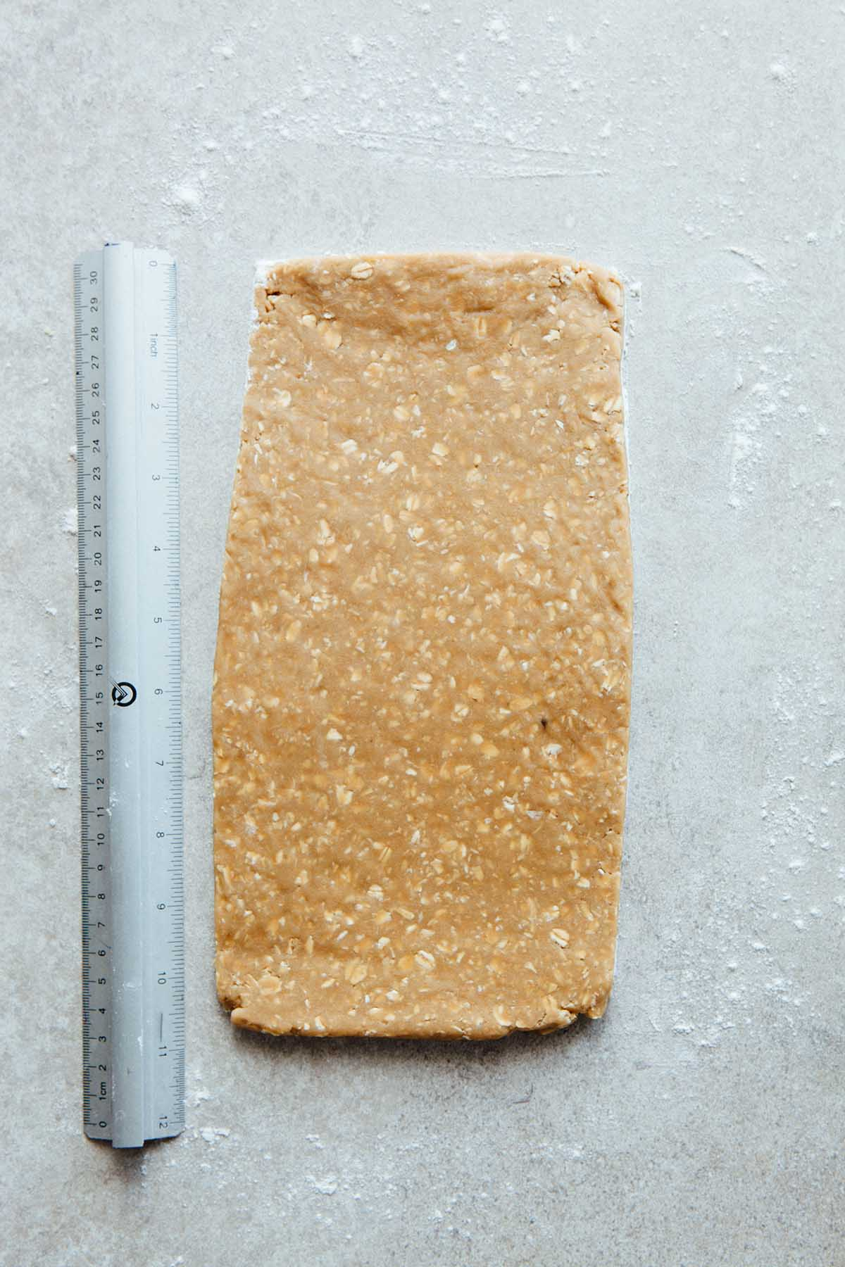 Rolled out oatcake dough with a ruler laying next to it to show size.