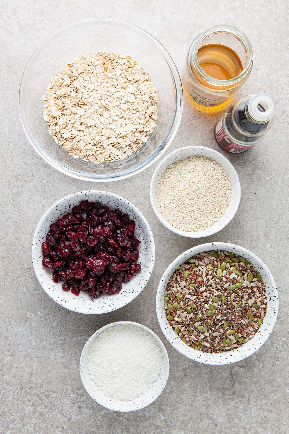 Ingredients to make nut-free granola with honey.