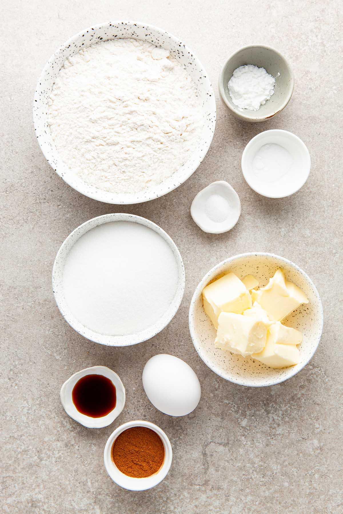 Ingredients to make snickerdoodles without cream of tartar laid out on a stone surface.
