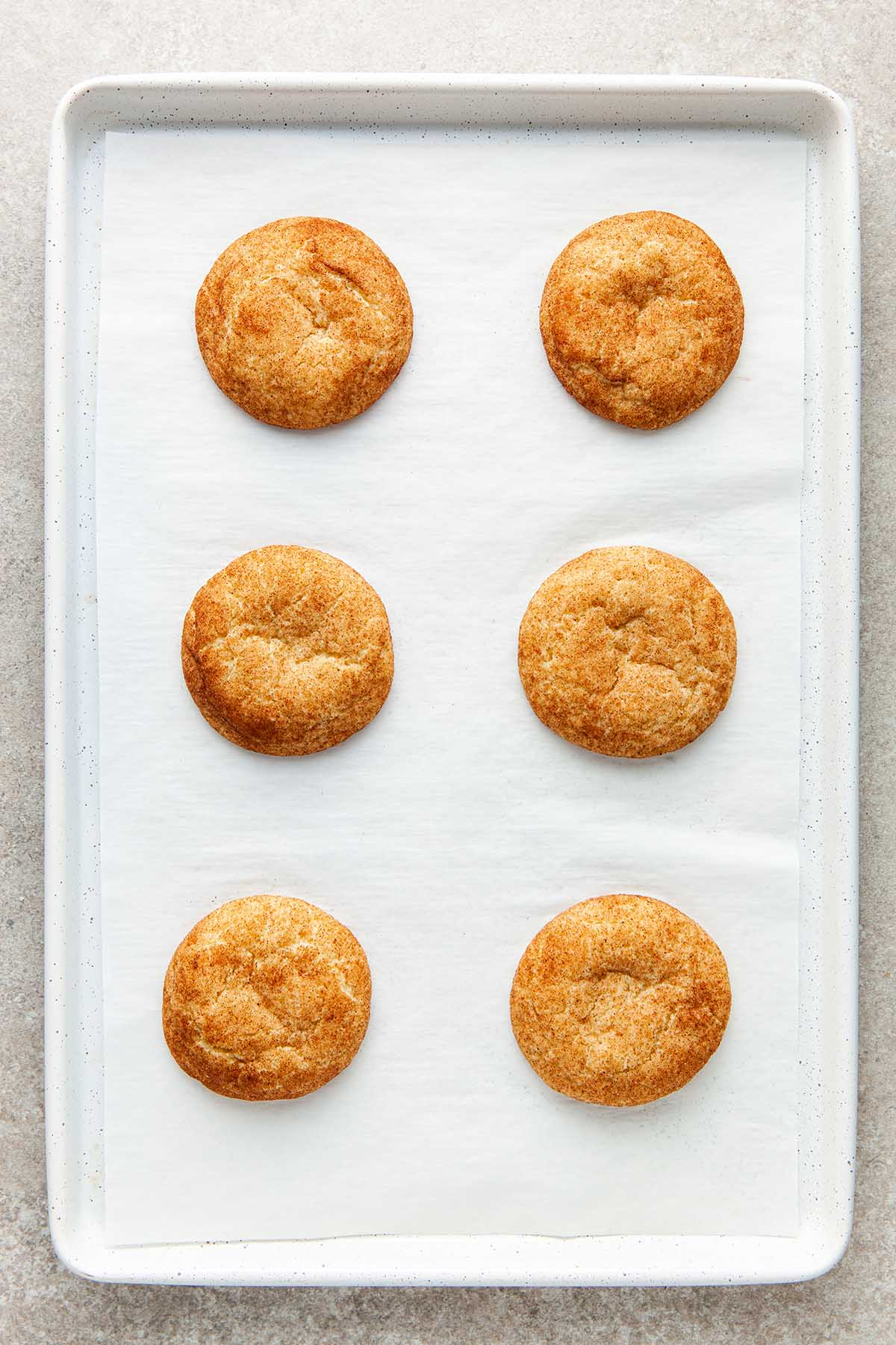 A pan of six baked snickerdoodles without cream of tartar.