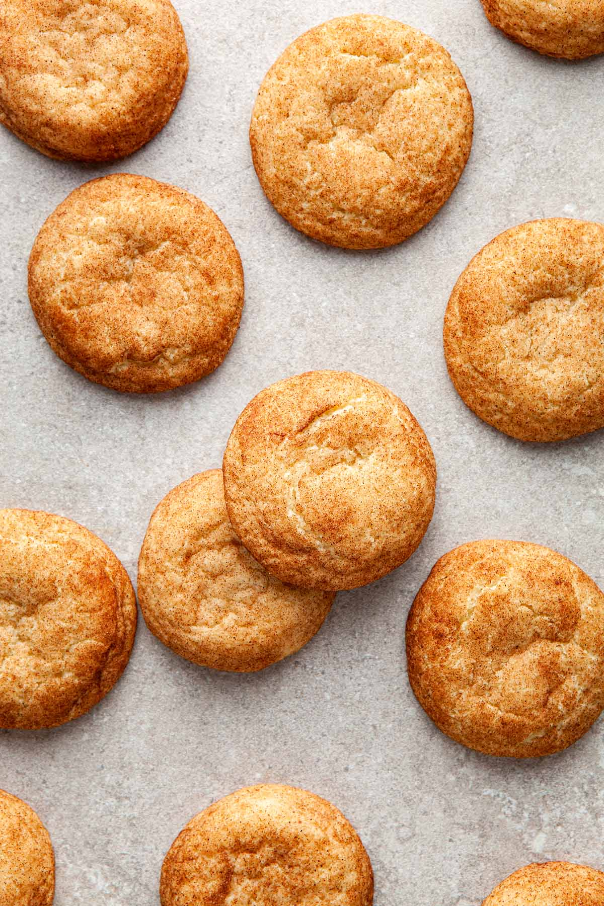 A pile of snickerdoodles without cream of tartar on a stone surface.
