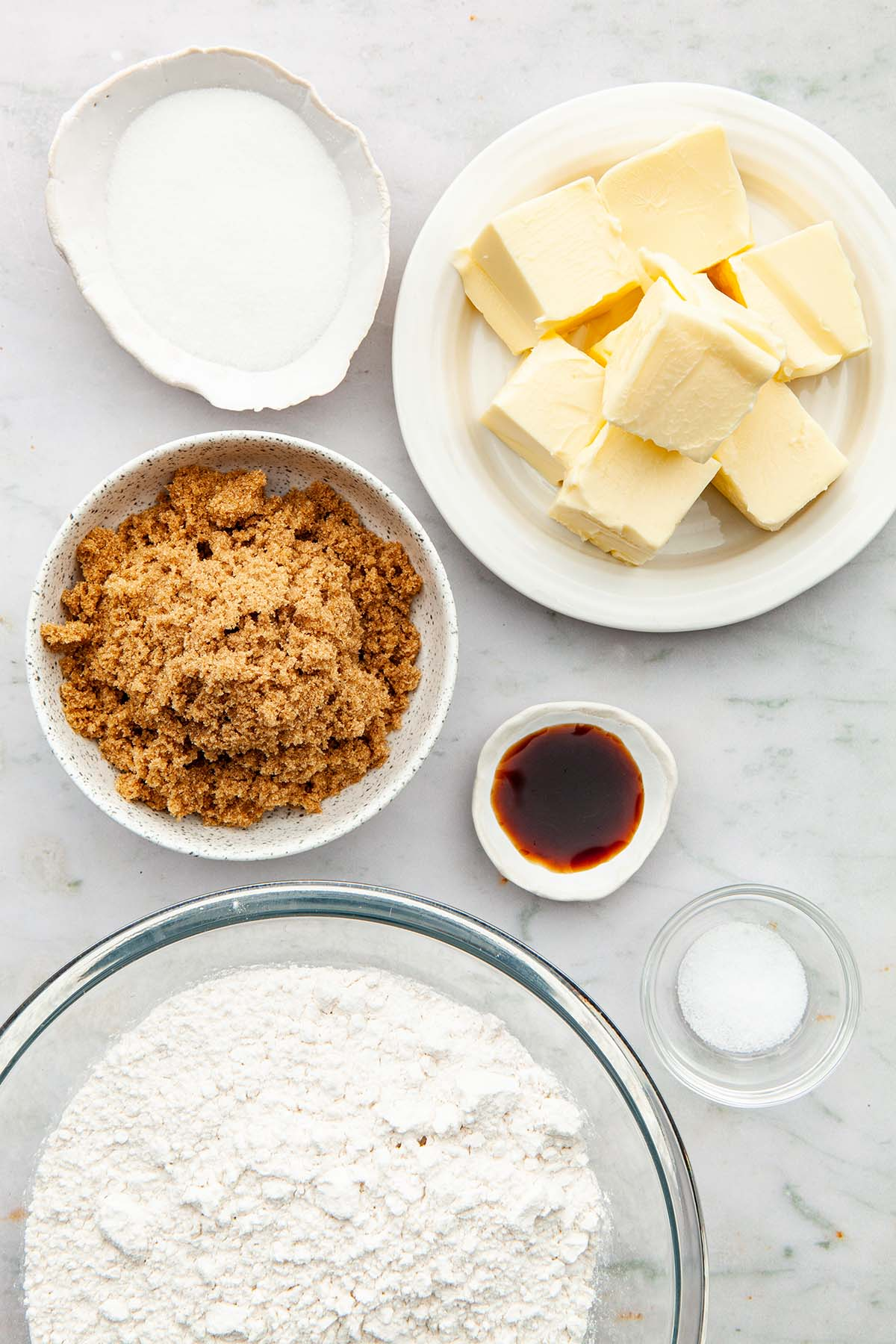 Ingredients to make stamped brown sugar shortbread cookies.