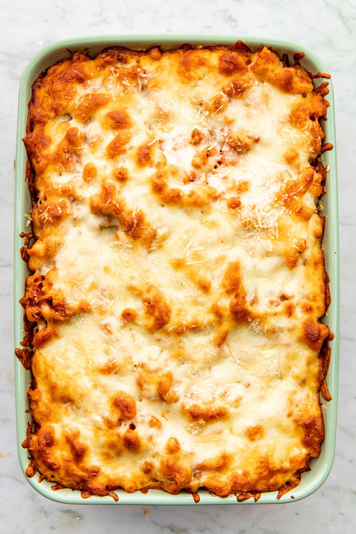 Close up overhead of a baking dish of Italian sausage casserole.