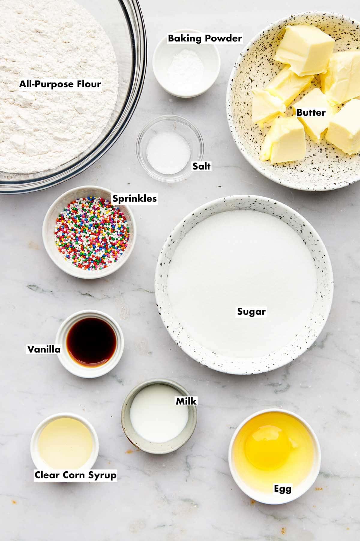 Ingredients to make sugar cookies with sprinkles.